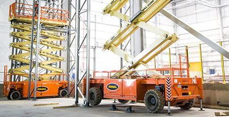 Riwal - installing racking in distribution center