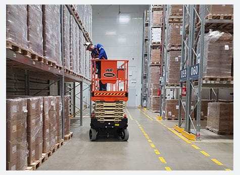 Riwal scissor lift in warehouse
