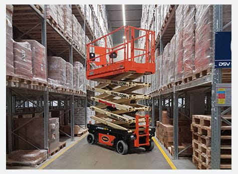 Riwal scissor lift in storage warehouse