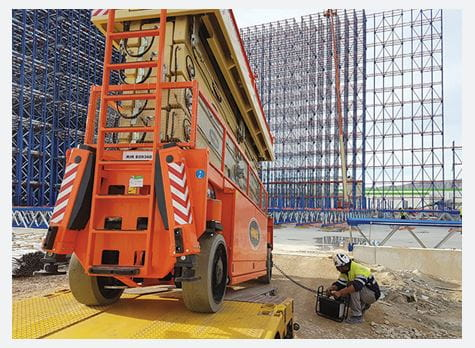 Riwal scissor lift being unloaded from truck