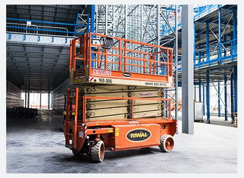 Riwal scissor lift in racking distribution centre