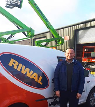 James McKinnell standing by Riwal van